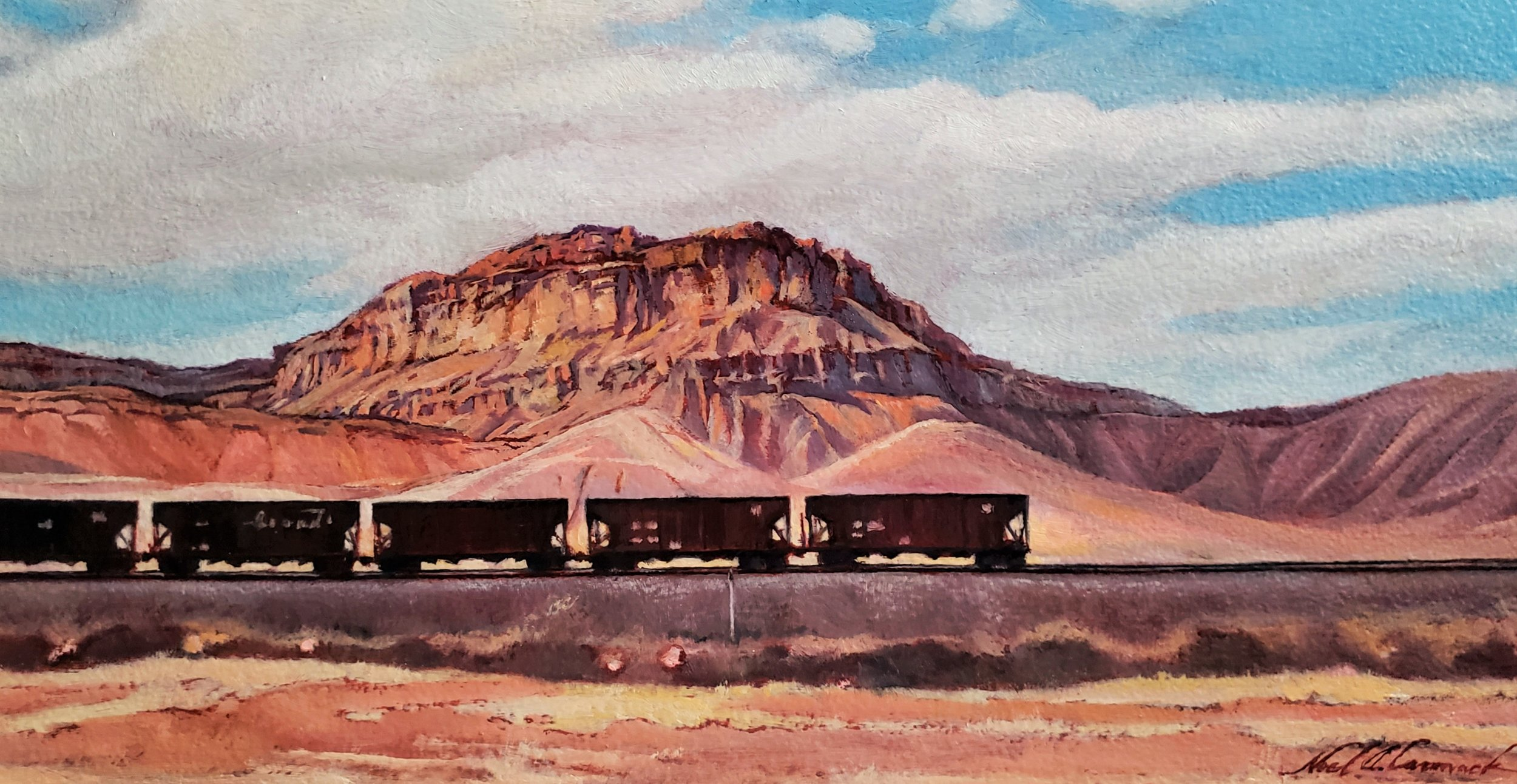 Hopper Cars below the Roan Cliffs at Green River, Utah