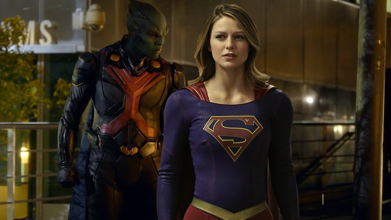 Supergirl! And Martian Manhunter! Even if you don't watch the show, you should be able to figure out which is which…
