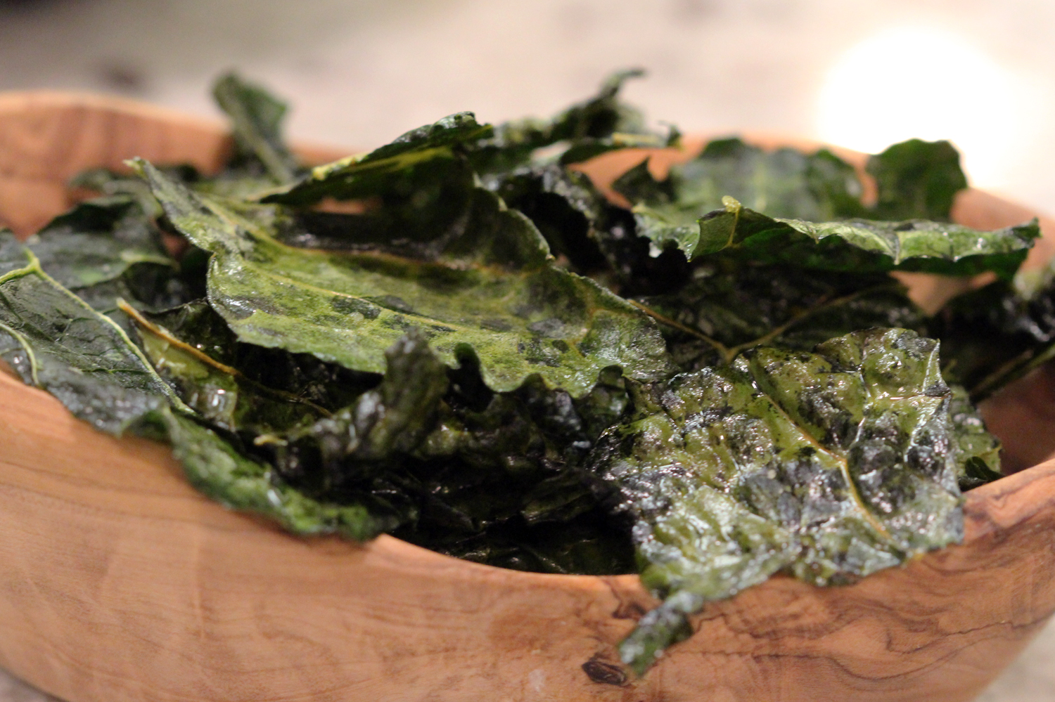 - ingredients-1 bunch of kale (any variety will work here, however, I like using black kale as it's flatter than other varieties and I like the way it dehydrates once baked. With that being said, use whatever looks best or what your favourite variety is)-2 tbsp good quality olive oil-sprinkling of sea salt to taste (this amount depends on the size of your kale bunch. Start with a small pinch and work your way up from there, tasting as you go)make it-preheat your oven to 300-thoroughly wash the kale and pat dry. Lay the kale flat on your cutting board to remove the thick inner ribbing. This part of the kale is particularly bitter and can be tough to chew through. Better to get rid of it.-slice the kale leaves into whatever size chips you'd like. Not too big, not too small. Add them to a large bowl and drizzle with olive oil. The important part here is to massage the oil into the kale. Otherwise, you'll notice the oil just sits on top and doesn't properly coat each piece. This step is crucial for extra delicious kale chips- do not skip.-once the kale has been massaged, sprinkle your sea salt over top and mix well to coat evenly-lay your chips out in a single layer on the pan. This step is also important, the chips need to be in a single layer otherwise they won't crisp up properly. Depending on the size of your pan, you may need to do a few batches-place in the oven and bake for 15-20 minutes until lightly crisp and dehydrated. You may need to keep checking them to make sure they are doing alright. You'll know once they are perfect.-allow chips to cool completely before transferring to a sealed container. Enjoy!