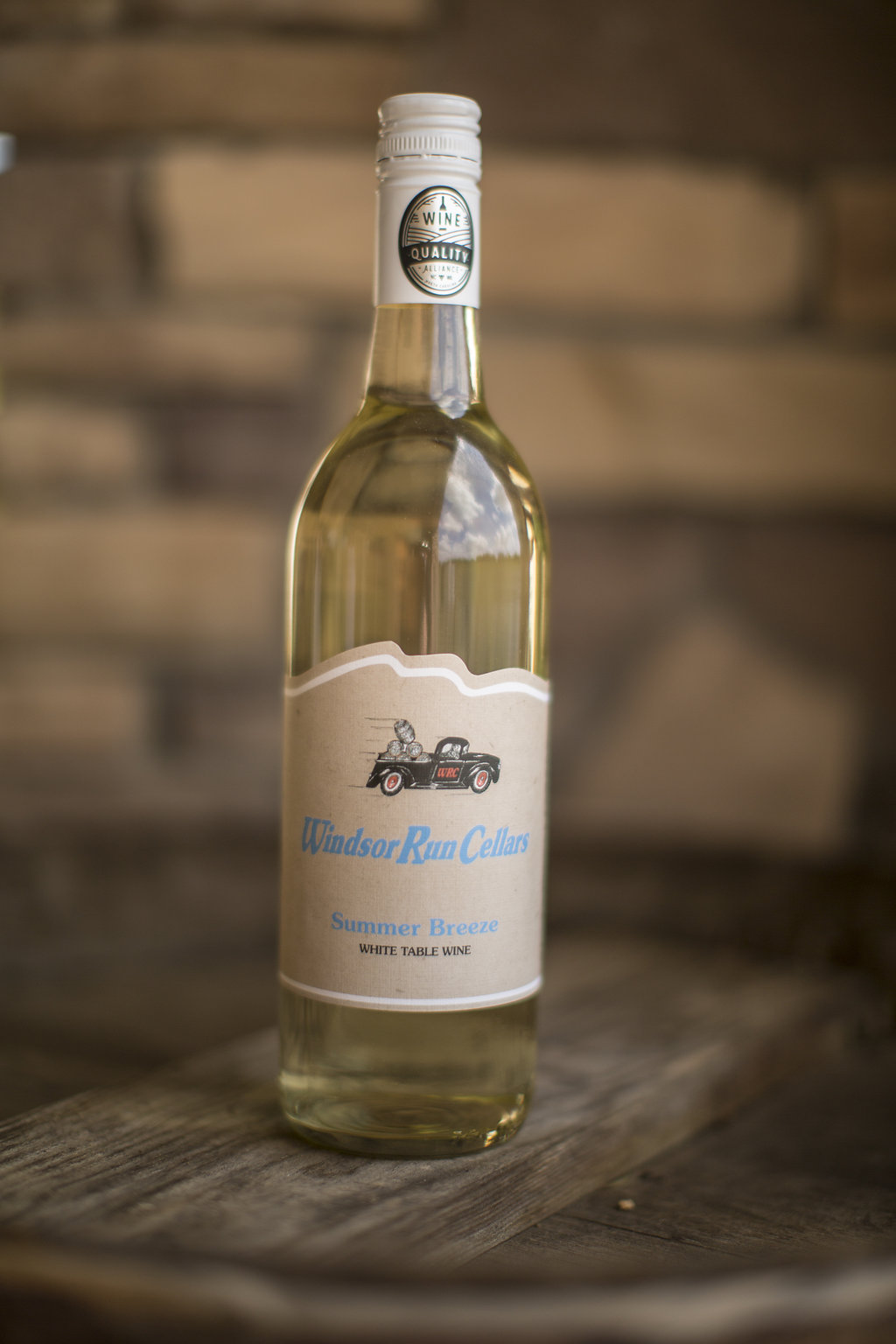 Summer Breeze  This Riesling and Muscat is a light sweet white wine complimented by notes of apricots, mangos, and peaches. The perfect wine for the beach, pool, or any summer activity  $18