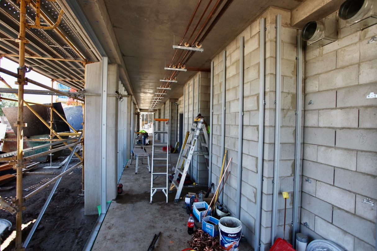 You'll have to use your imagination, but it's easy to see how this wide and spacious corridor will become a feature in the new Motel.