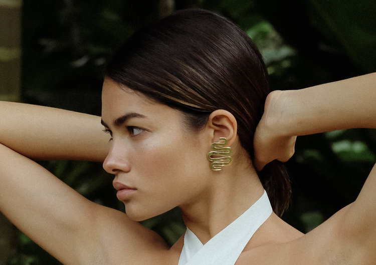 Luiny    Contemporary metal jewelry with sculpture and wearability in mind. Luiny Rivera, designer and Puerto Rican native, created jewelry with her travels and lifestyle in mind from her New York studio.