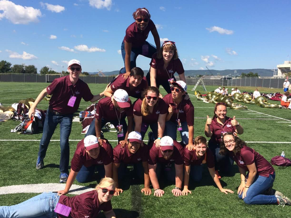 The 2017-2018 Manager Section making their Game Day Pyramid. I am the person single-handedly messing it up in the second row from the top! Source: Facebook.