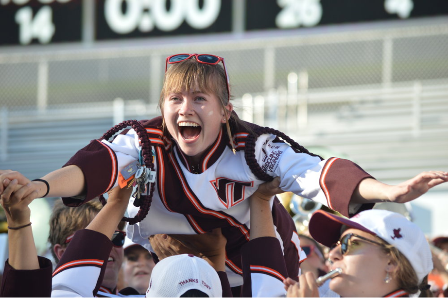 """Anne Kelly Newman being lifted by her section while the band plays """"Superman;"""" Source:  The Spirit of Tech"""