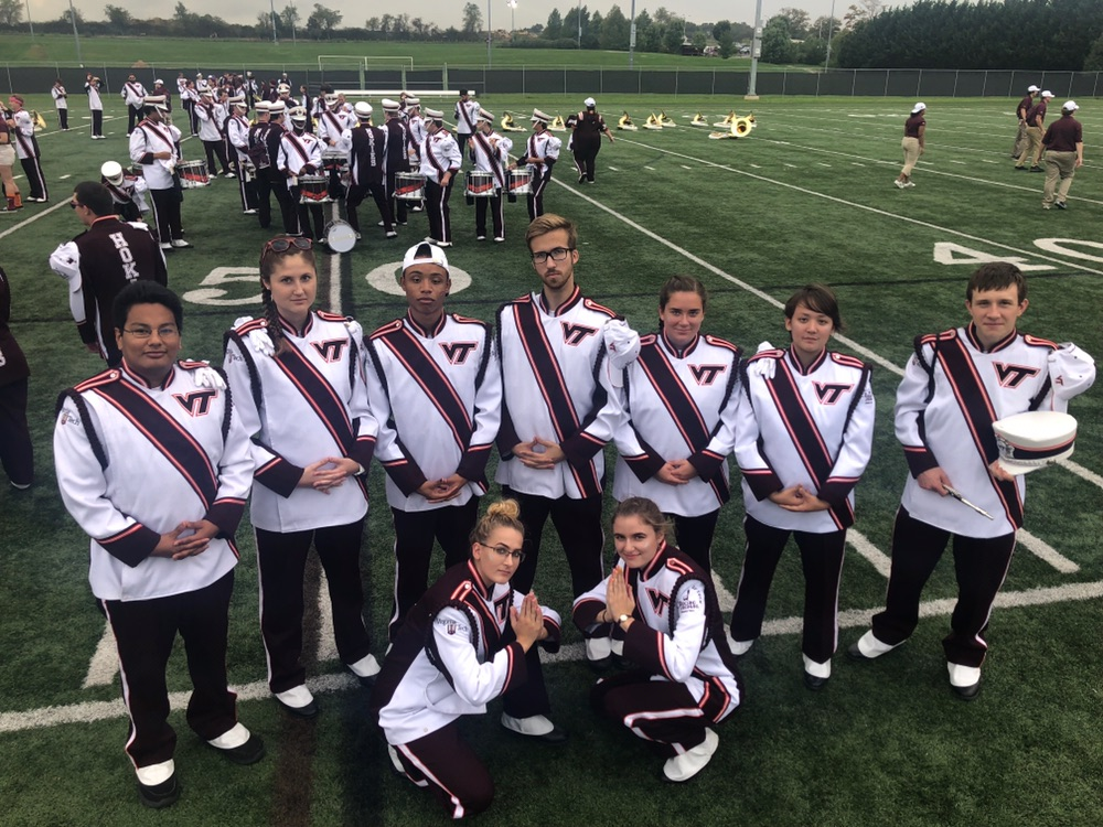 Atlas Wass and and the piccolo's Rank 7 posing together on game day; Source: Alyssa Wills