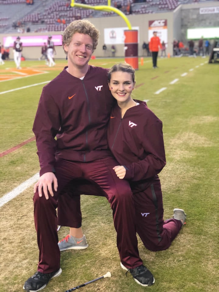 Feature twirlers Connor Rudd and Meredith Smith  on game day; Source: Facebook
