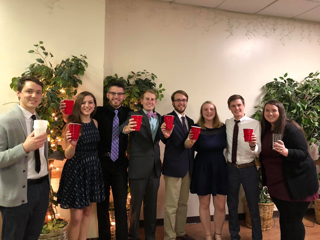 """The graduating members of the Virginia Tech Drum Line and their 4-year """"mugs""""; Source: Nathalie Unico"""