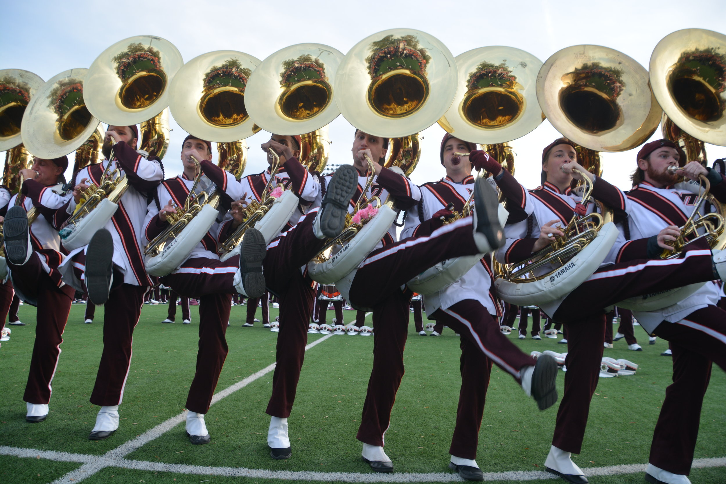 "The Marching Virginians Super Sousaphone section dancing ""The Hokie Hokie"" at Hokie Village; Source: Alana Hassett"