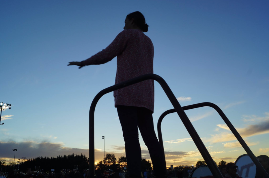 Ashlyn McDonald conducting the band during a chilly November rehearsal; Source: Lexie Hackman