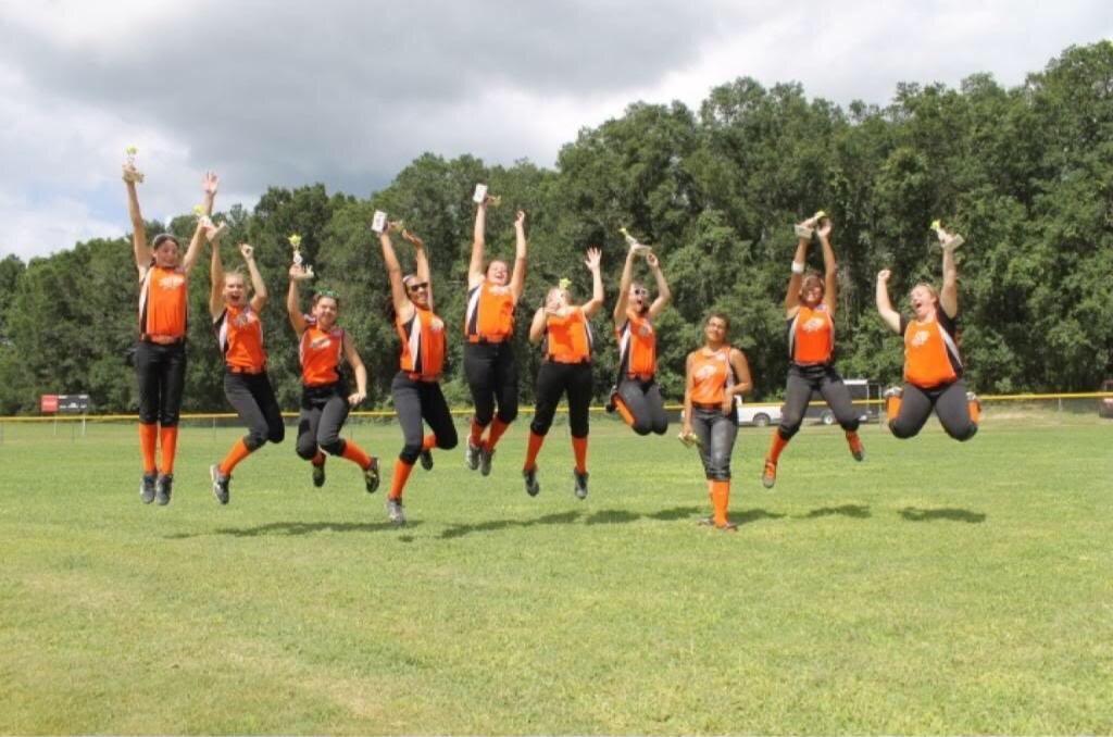 Noelle's softball team in July 2013; Source: Nicole Dobbs