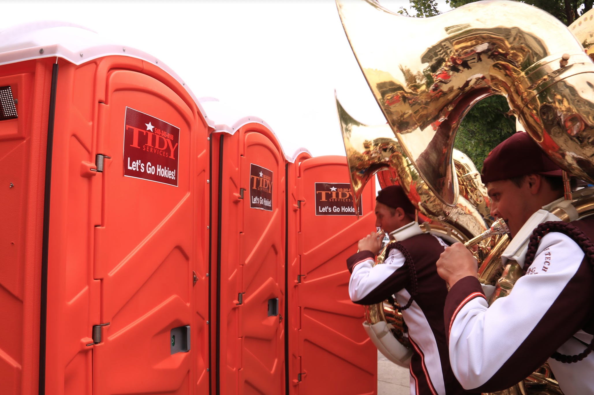 "Tuba players ""surprising"" porta-potty patrons with a loud tone; Source: Ashley Deans"