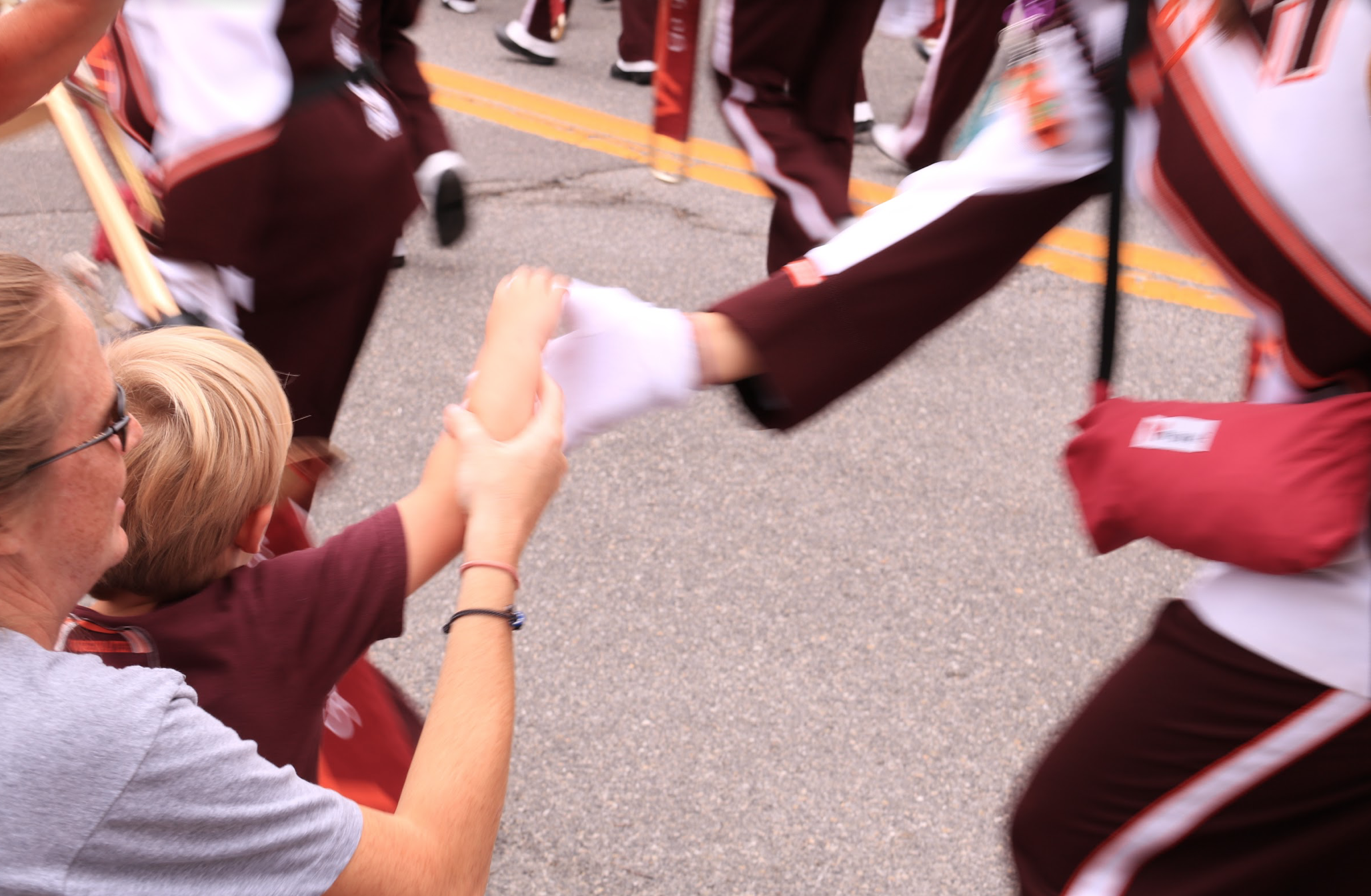 High-fiving kids is the highlight of the March to Victory for many MVs; Source: Ashley Deans