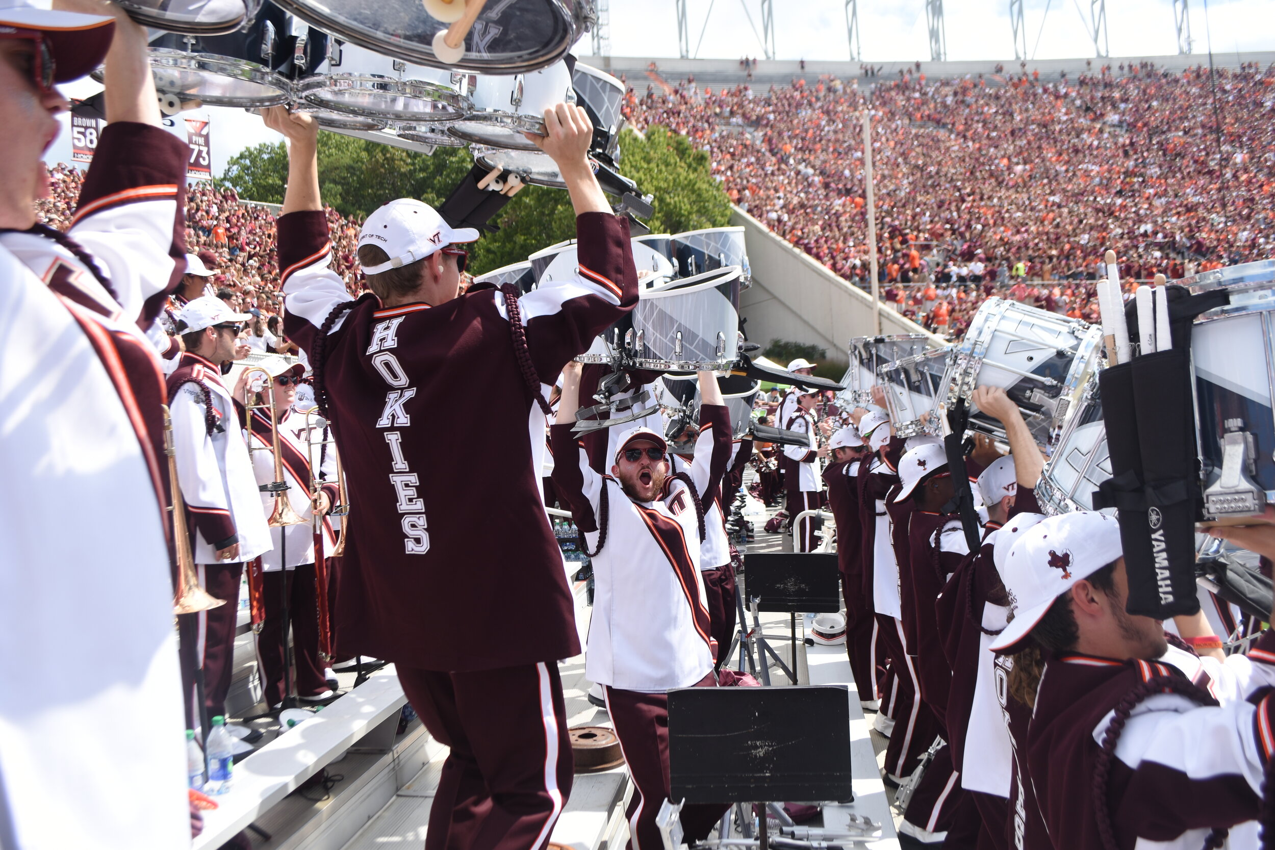 The new (taxing) drumline tradition is to lift the drums during certain parts of the game; Source: Drew Robertson-Gouge