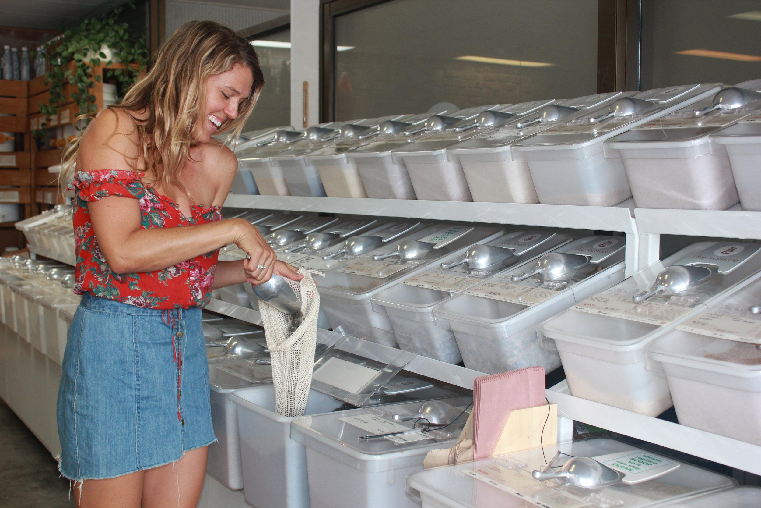 Filling reusable cloth bag.JPG