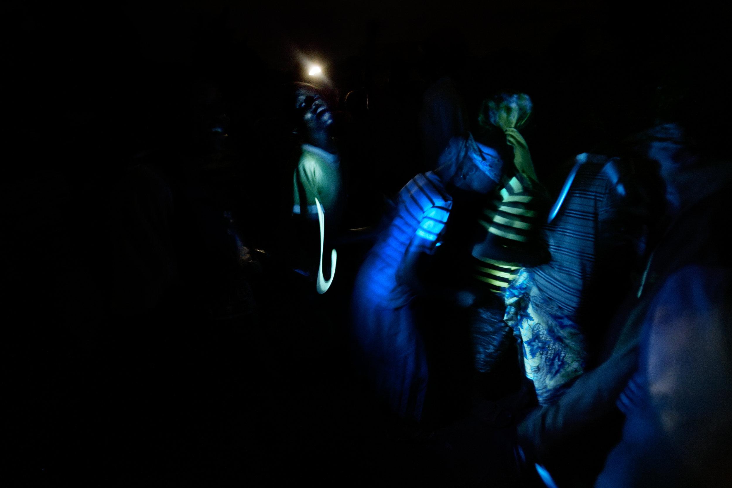 Children dance by flashlight outside of Wantugu, Northern Region, Ghana on June 30, 2007.