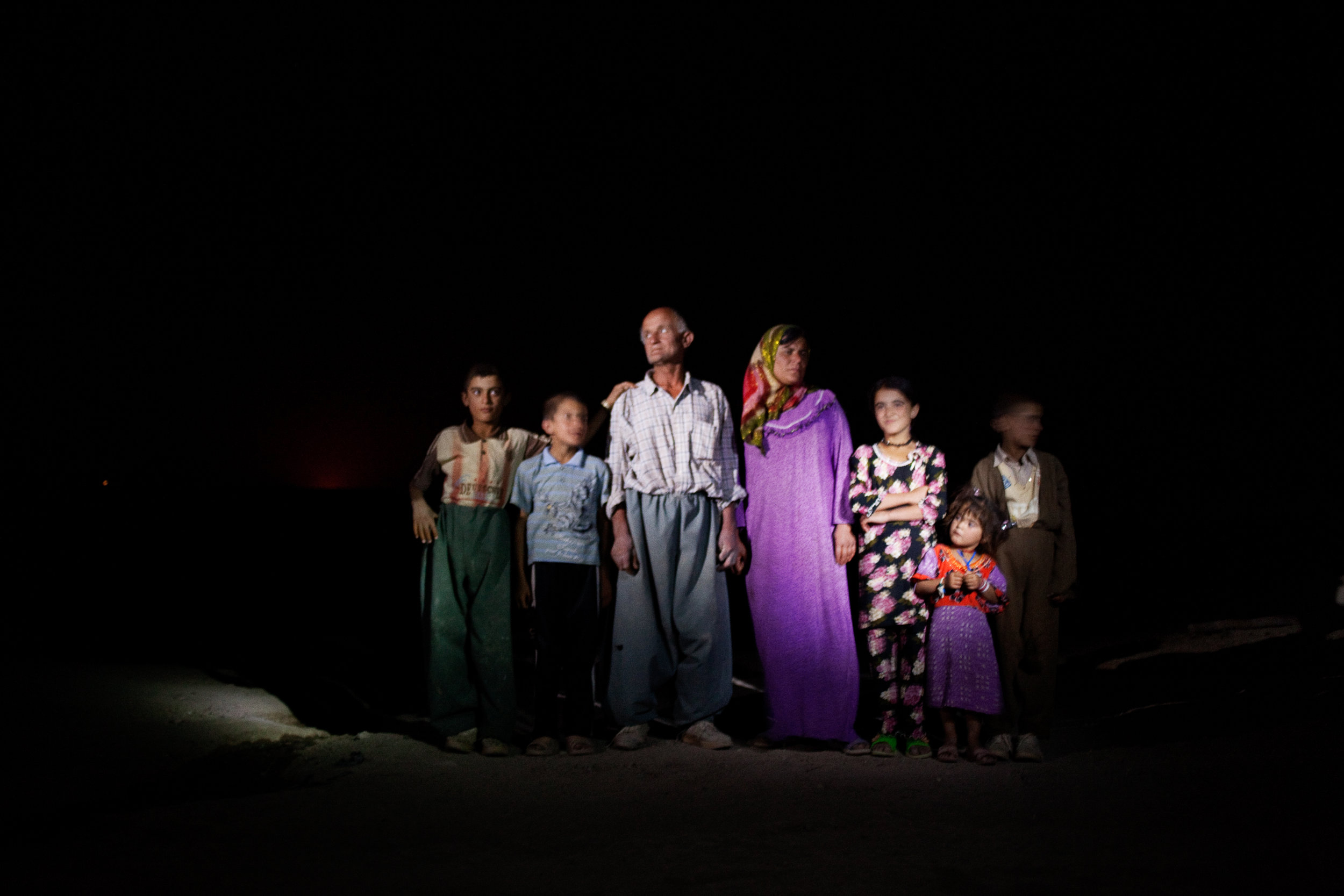 Nashmil Aziz Rashid, her brother-in-law, Khalaf Mohammed Qochakh, and the children of their household in Binika, Kurdistan, Iraq. on July 11, 2010.