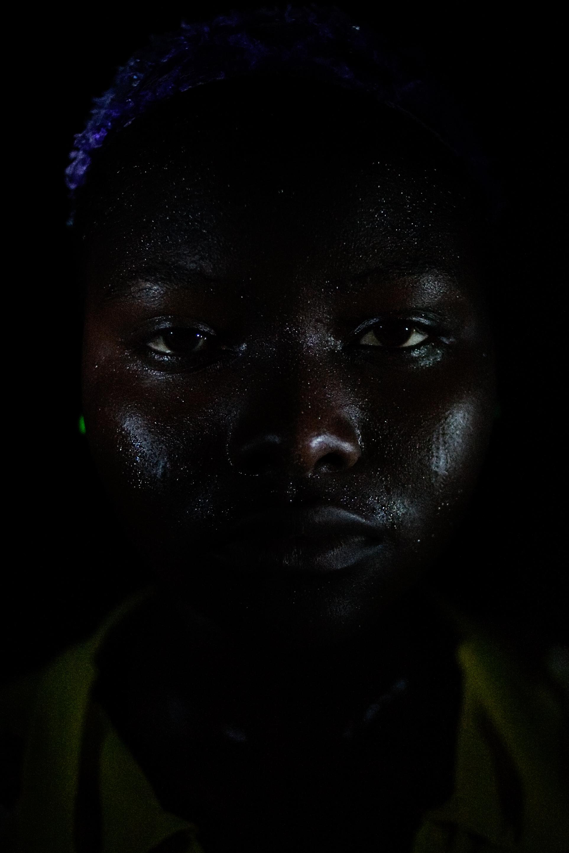 Nasiba Salifu, sweating from dancing, in Voggu, Northern Region, Ghana on Feb. 19, 2010.