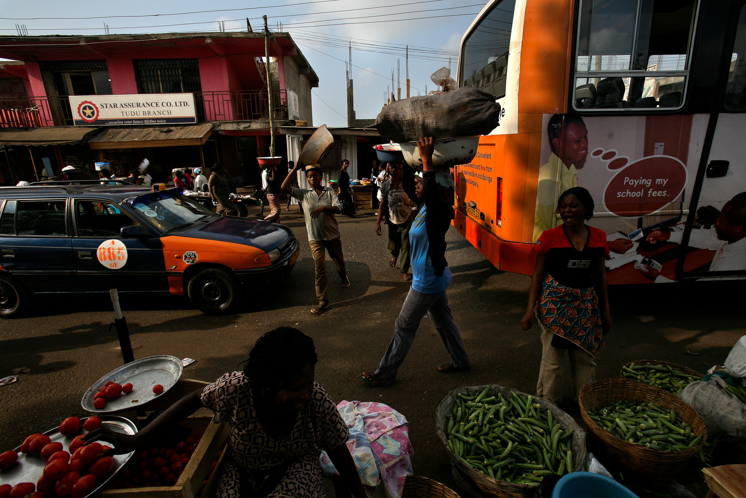 25-year-old Lamisi, center, carries a load of yams from one market to another in Accra, Ghana on Feb. 11, 2009. Lamisi graduated from Senior Secondary School in Tumu, her home in Ghana's remote Upper West Region, but had to travel to the faraway city to make money. She is hoping to save enough to pay for admission to training college for teaching or nursing.