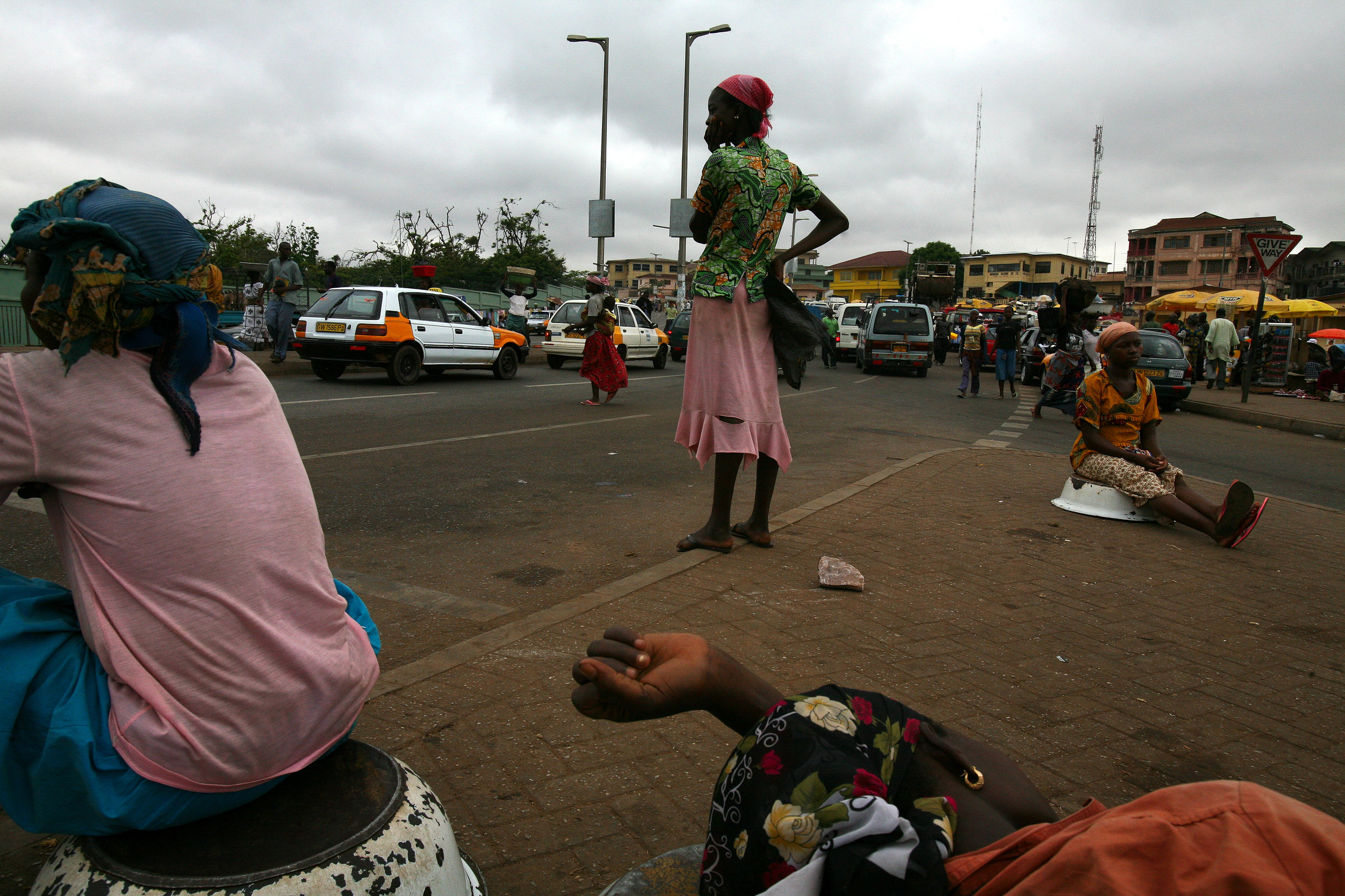 Girls from northern Ghana wait for work at an intersection in Kumasi, Ghana on April 10, 2009.