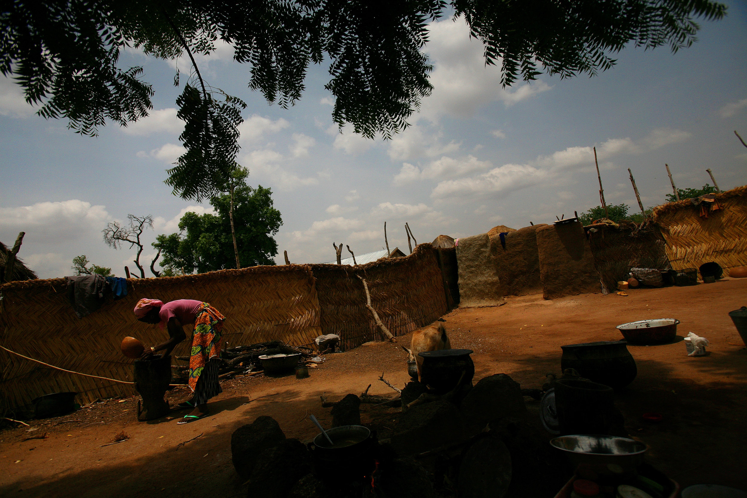 Amariya does chores in her husband's family's compound in Tampion, Ghana on March 25, 2009.