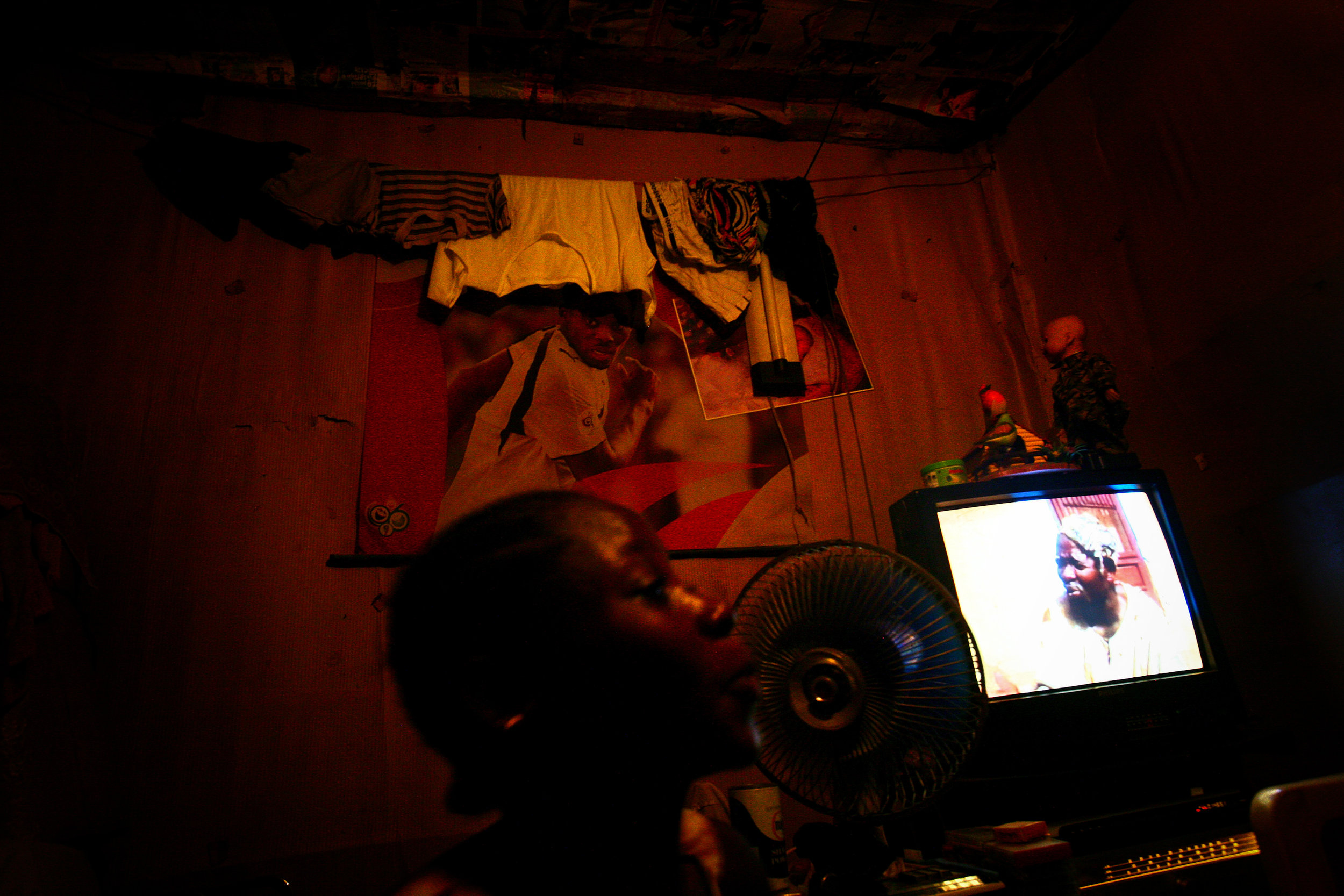 A young woman watches a film in her room in Accra, Greater Accra Region, Ghana on Oct. 5, 2008.