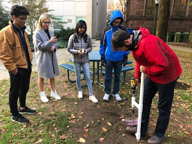 Undergrad engineers unveiling the new soil extractor jig to Dr Covey!