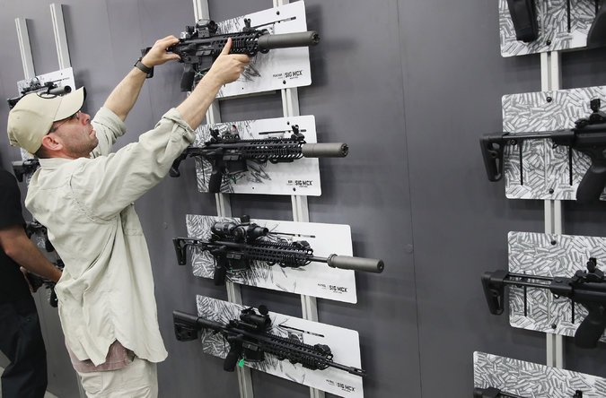 Sig Sauer MCX rifles on display at the National Rifle Association's Annual Meetings and Exhibits on May 21, 2016, in Louisville, Ky.Credit: Scott Olson/Getty Images