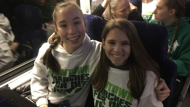 Piper Coleman, left, and Ellie Meyer, joined a group of about 340 people from Newtown traveling to the March for Our Lives in Washington, D.C. (Rebecca Lurye)