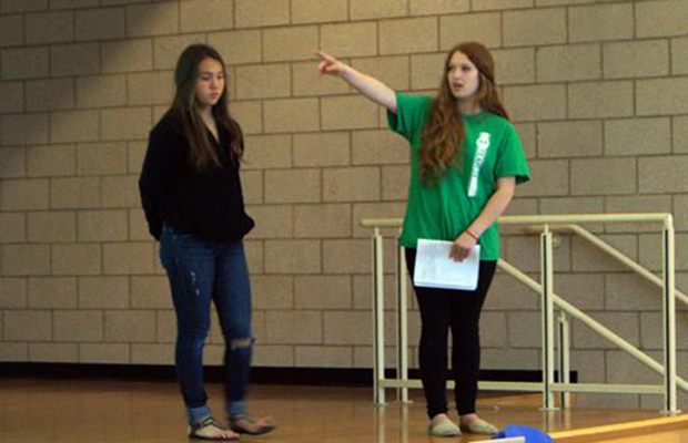 Student leader Sarah Clements walks members of her community through how to write an effective letter to Congress.