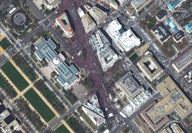 This aerial photo from space shows the streets of the nation's capital teeming with people at the rally, organized by the survivors of the Marjory Stoneman Douglas massacre