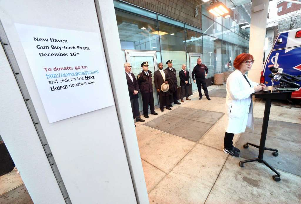 Dr. Gail D'Onofrio, chief of emergency services at Yale New Haven Hospital, speaks during a news conference in an ambulance bay at the hospital Tuesday.