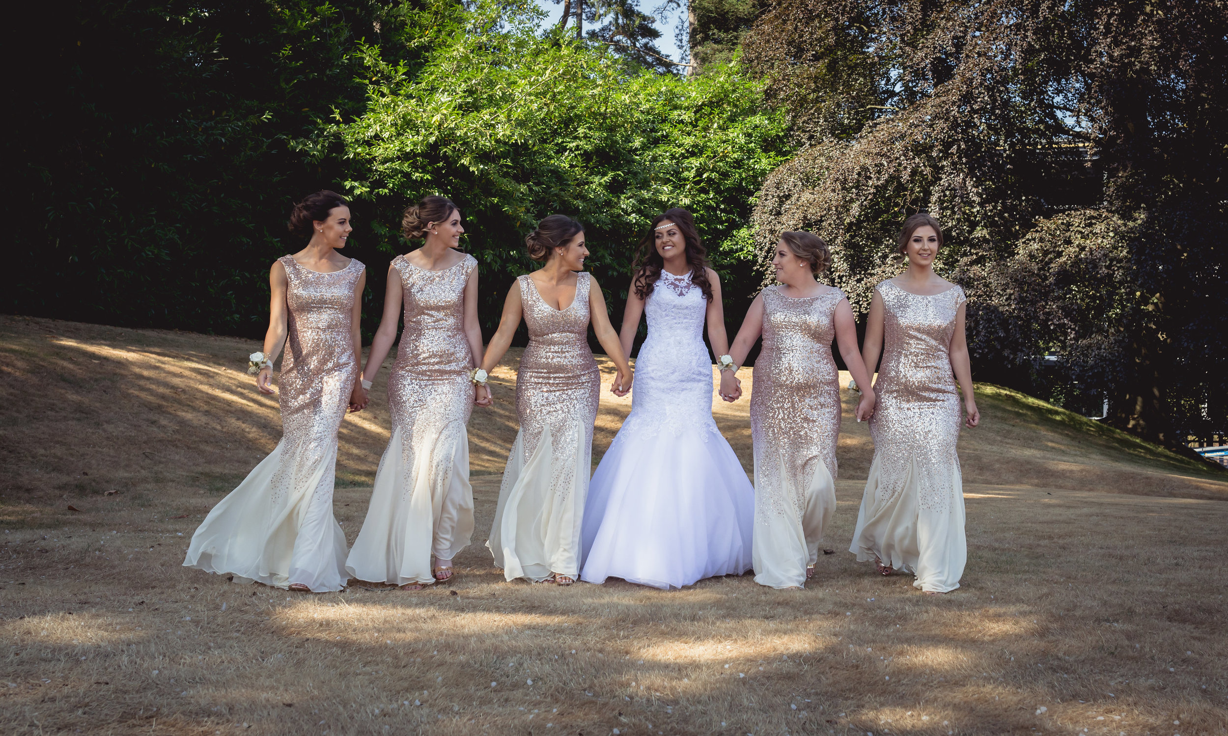 Photograph of bride and her bridesmaids