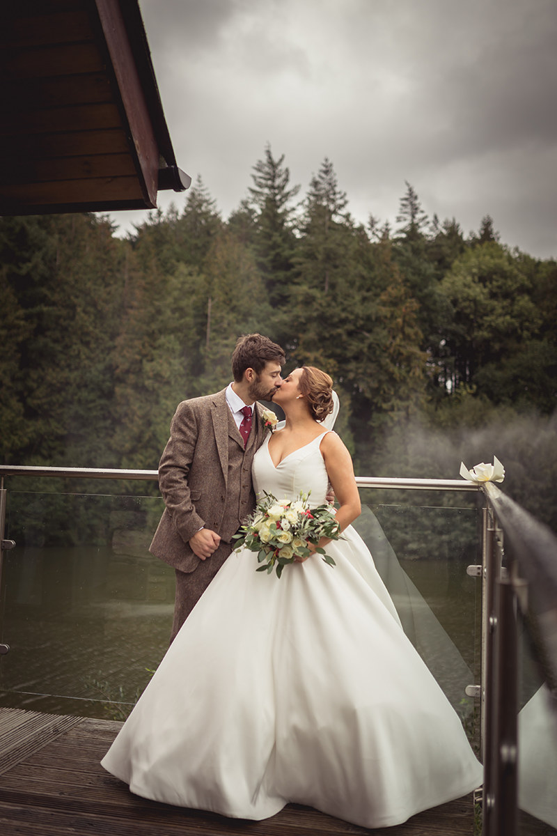 Portrait of bride and groom on a balcony at Canada Lodge near Cardiff