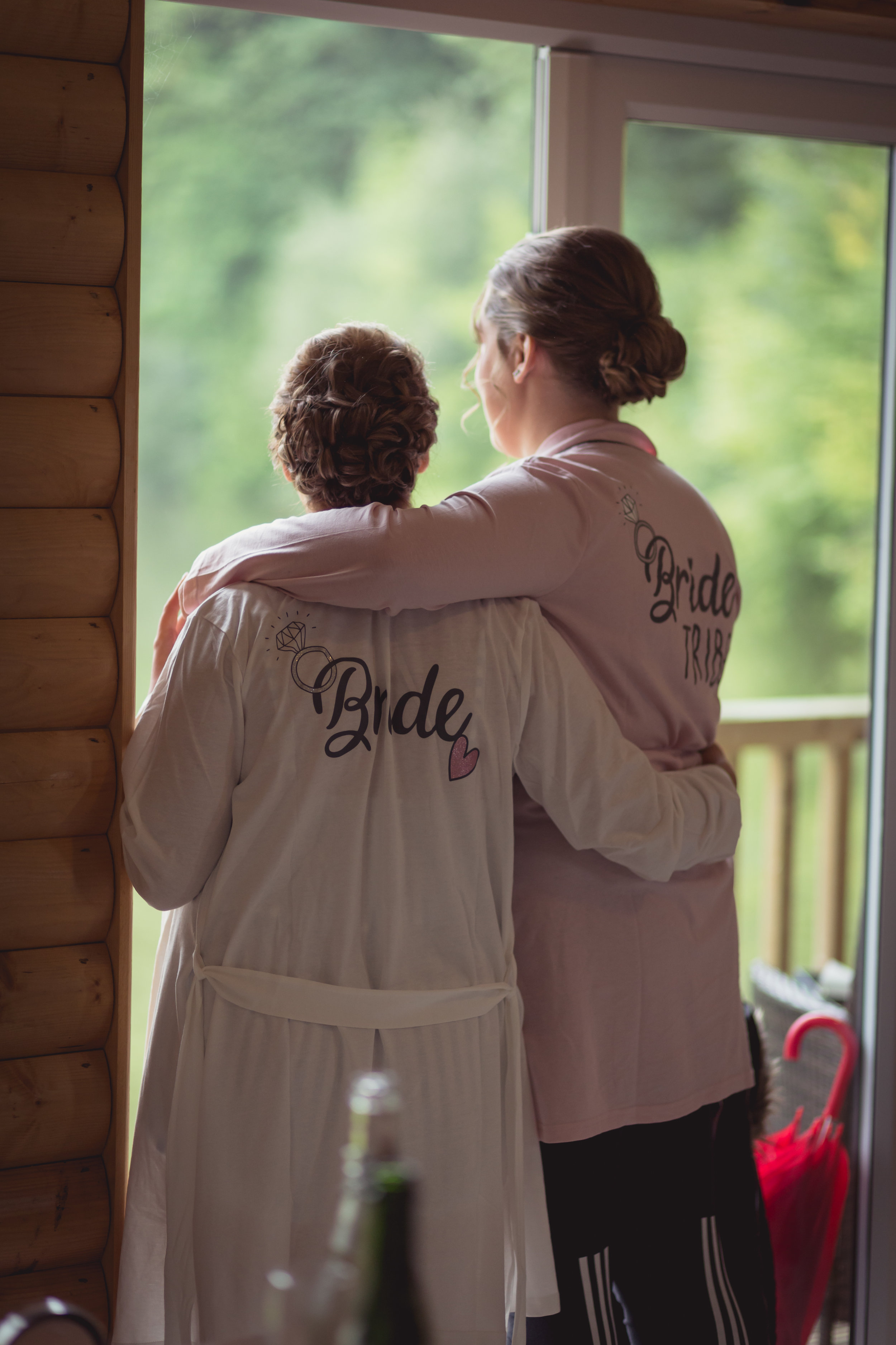 Bride and her bridesmaid looking out over the lake at Canada Lodge and Lake wedding venue