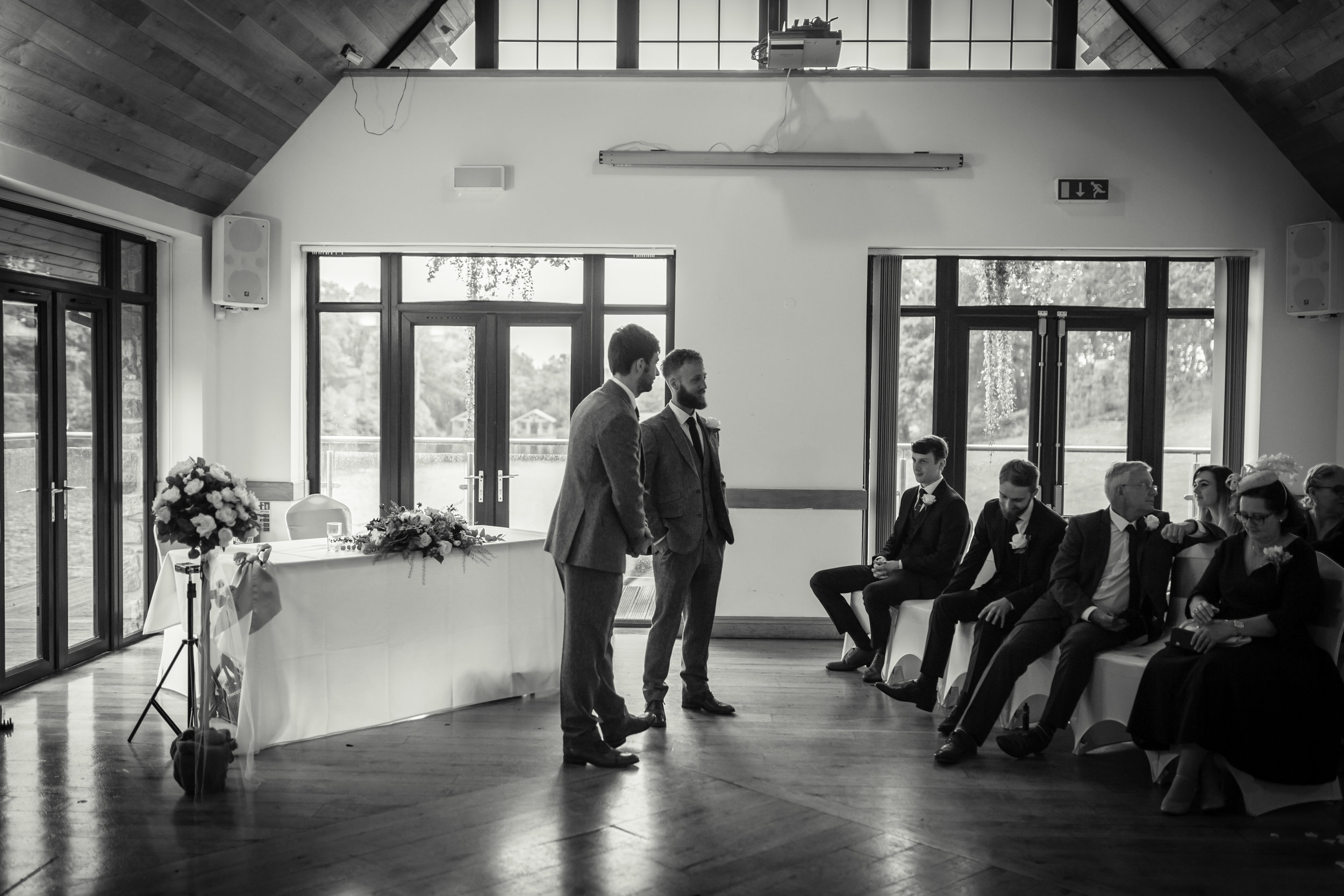 Black and white image of the groom with his best man awaiting the brides arrival at a wedding near Cardiff, South Wales