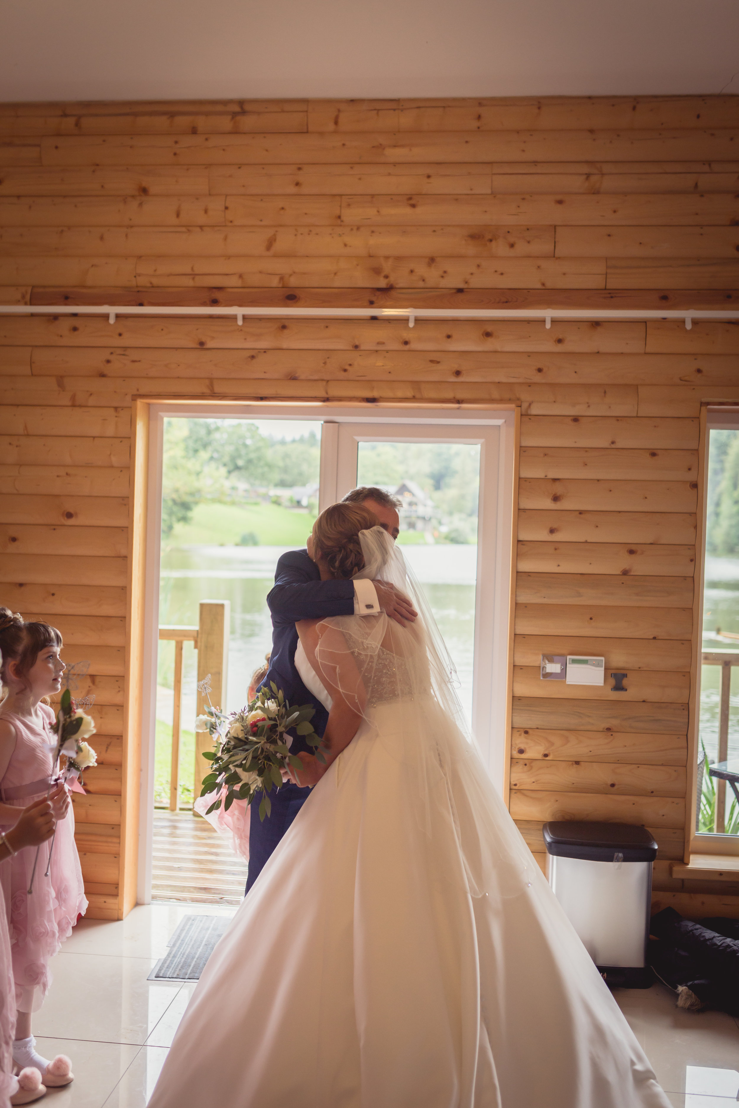 bride and her father huggin just before the wedding ceremony