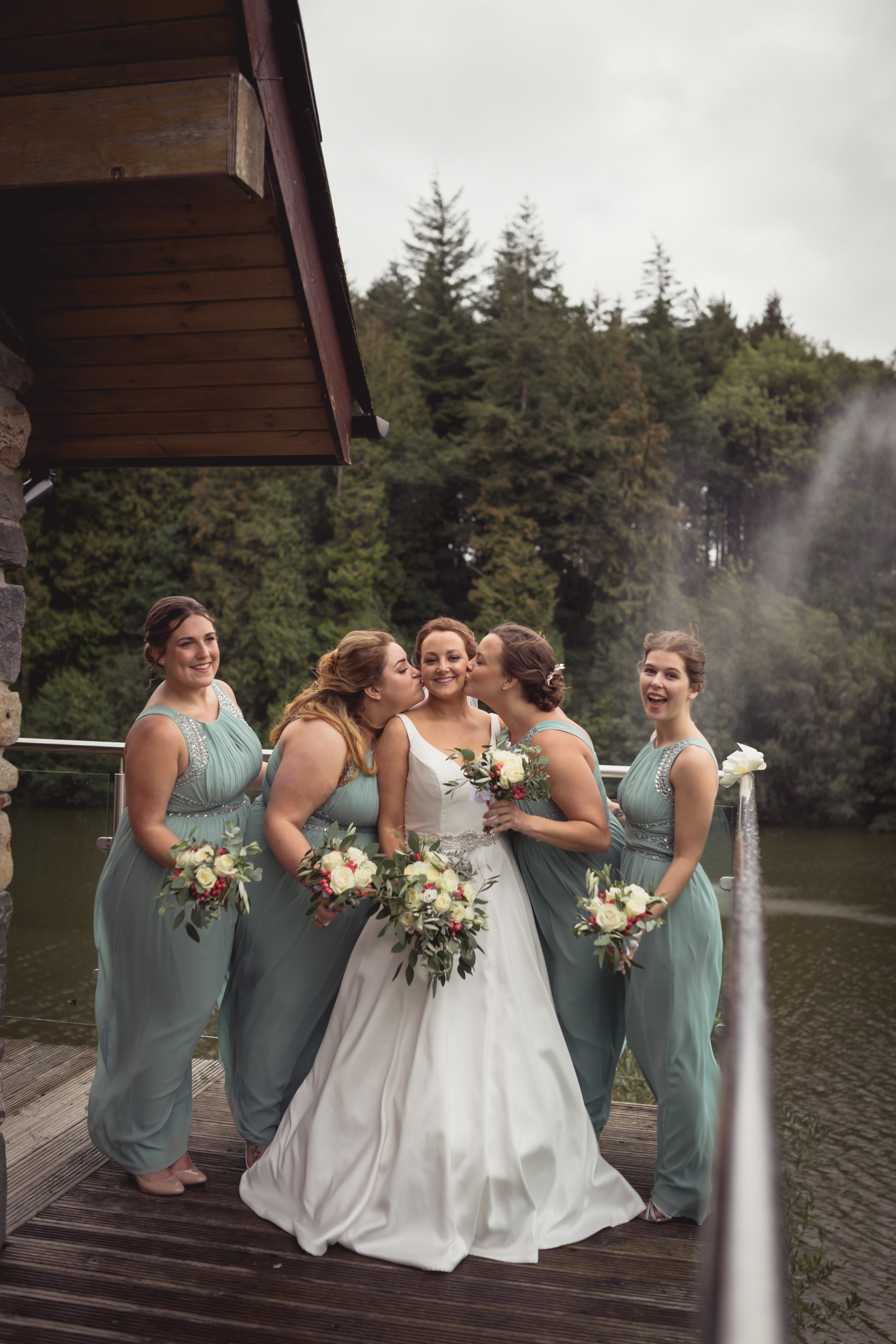 Photograph at Canada Lodge of a bride with her four bridesmaids next to her