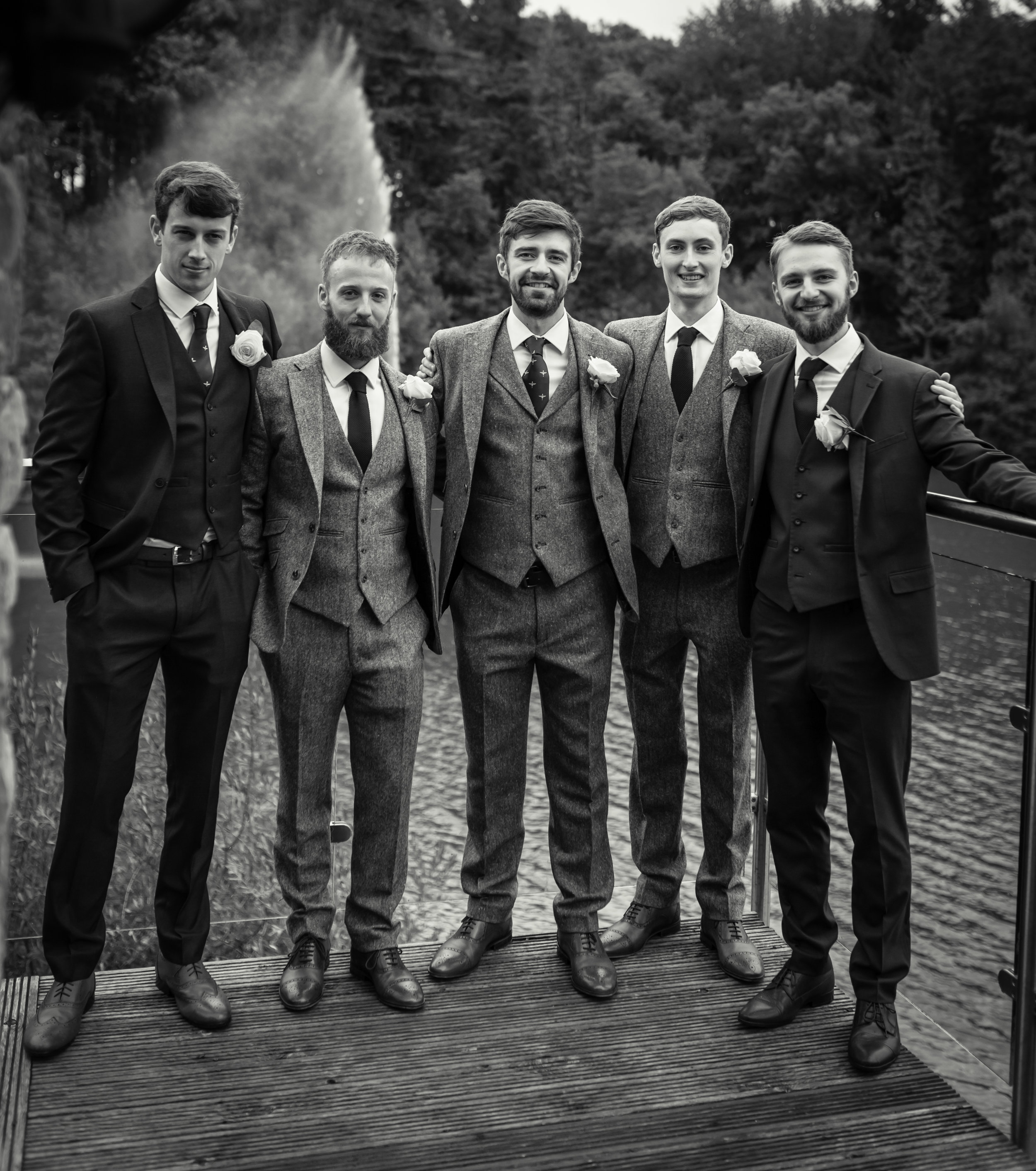 Black and white photograph of groom with his groomsmen