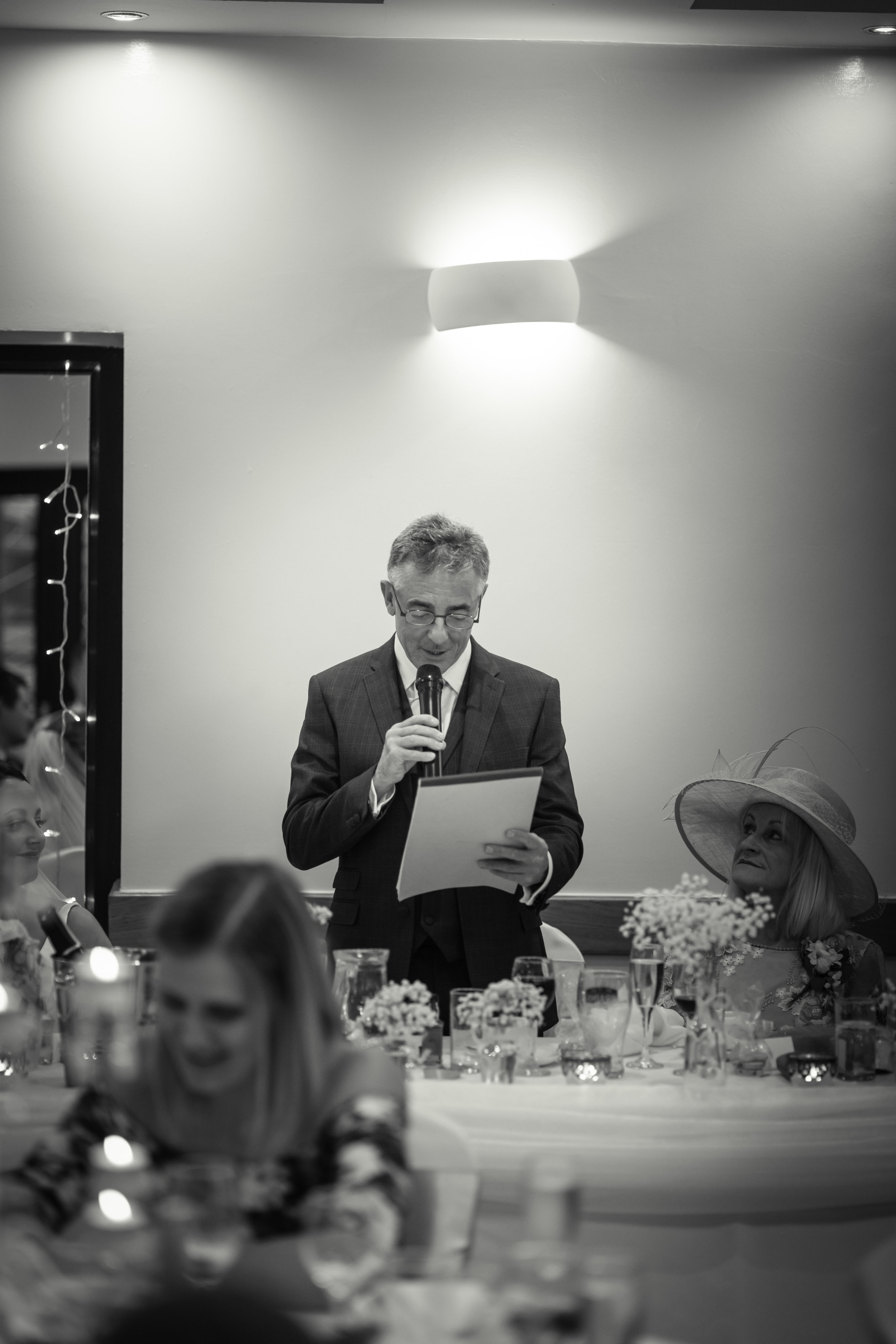 black and white photograph of the father of the bride giving his wedding speech