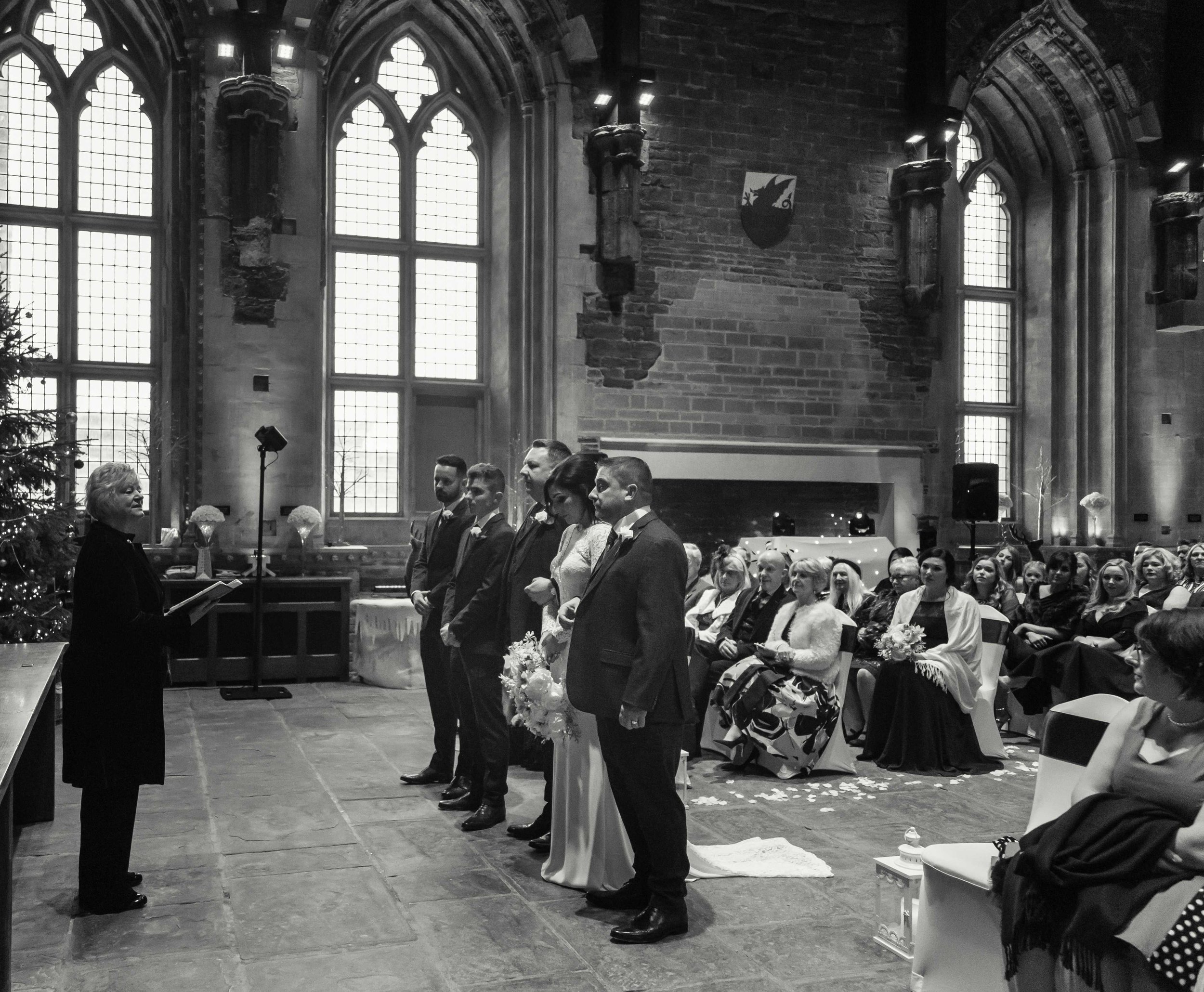 Black and white photograph of wedding ceremony at the Great Hall, Caerphilly Castle