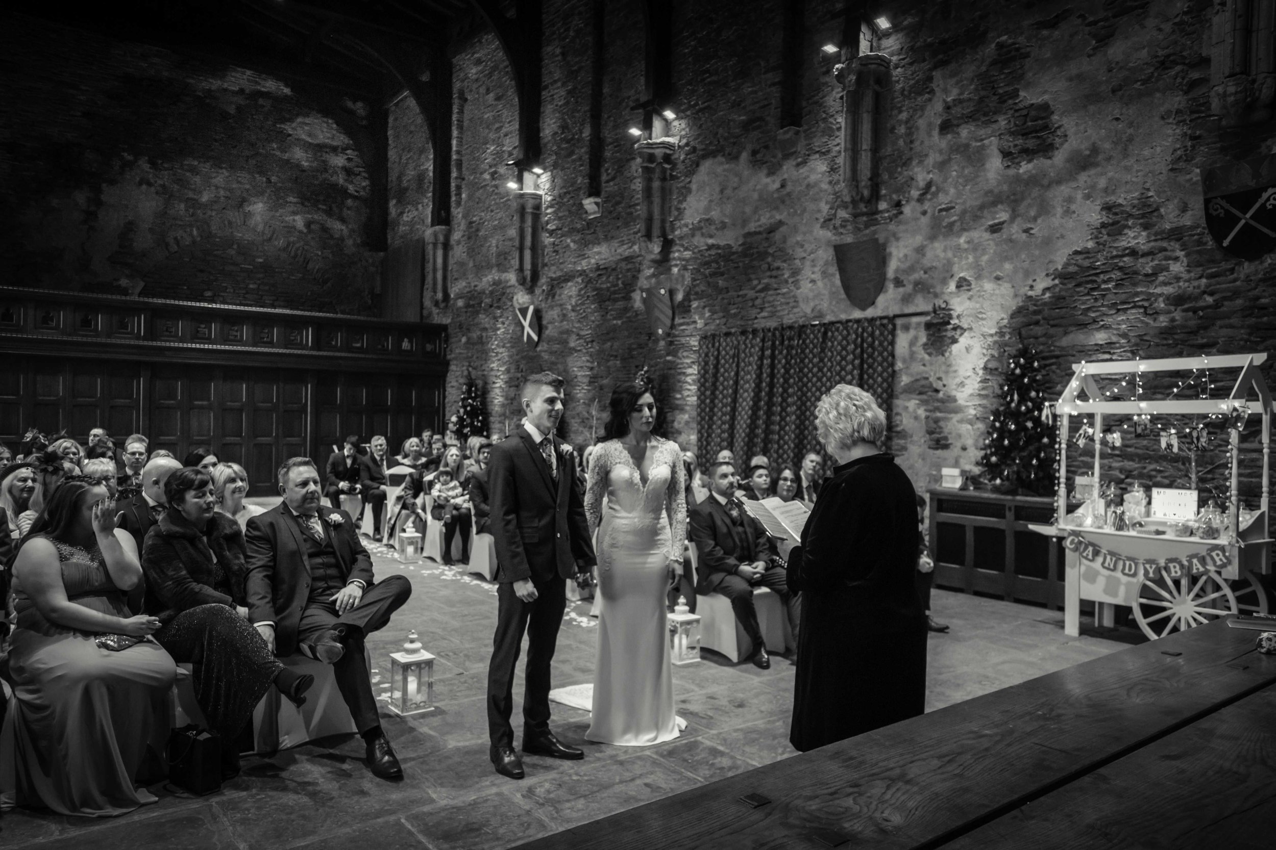 Black and white photograph of bride and groom at Caerphilly Castle wedding ceremony