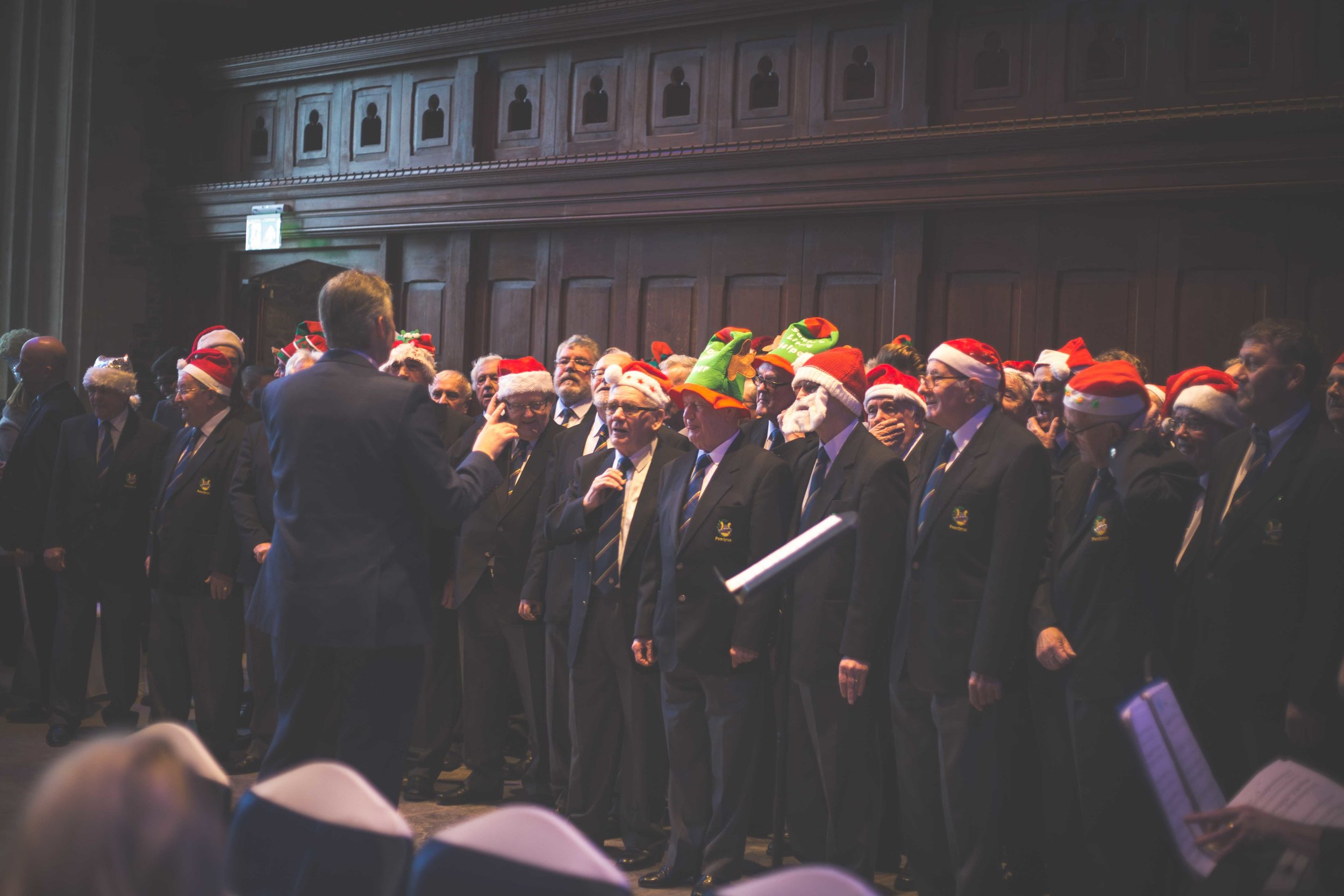 A Welsh male voice choir singing christmas hymns