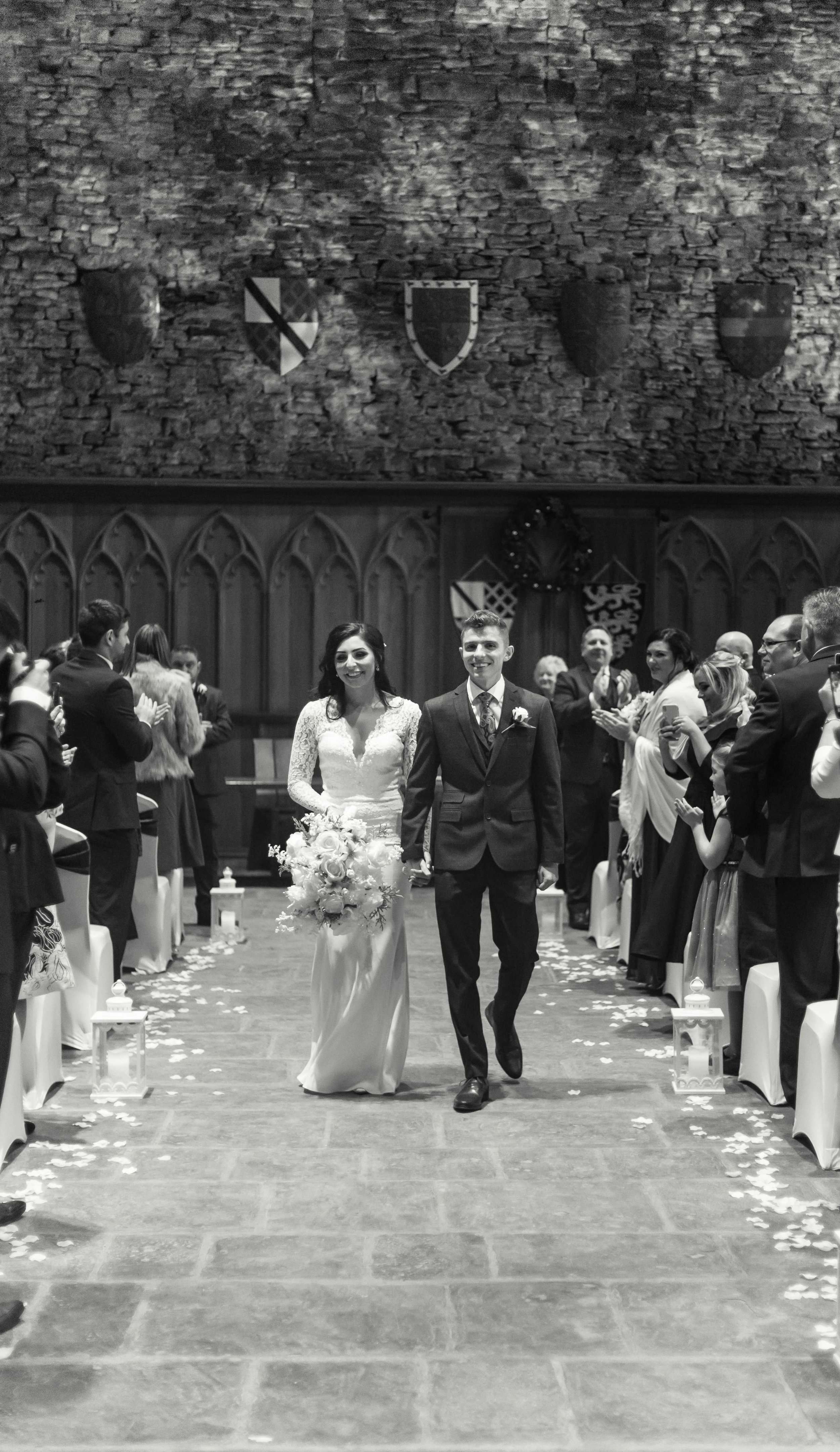 Bride and groom walking up the aisle leaving the wedding ceremony