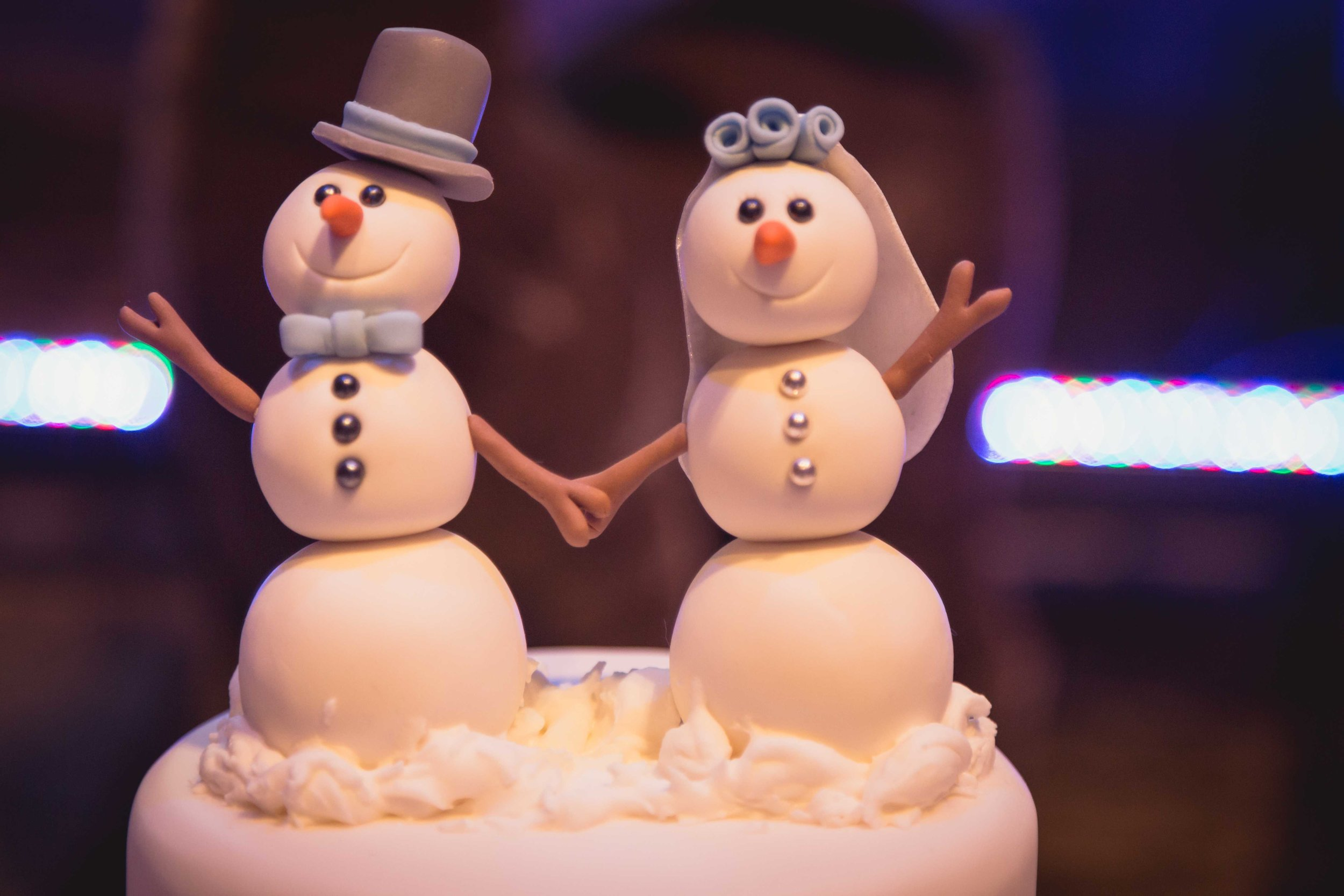 Close up image of weeding cake toppers