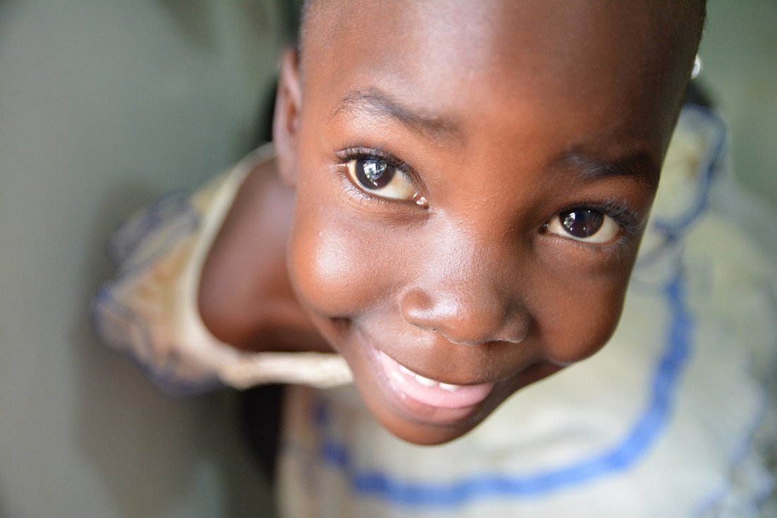 Novellah smiles at the camera. We can see the cataract in her right eye.