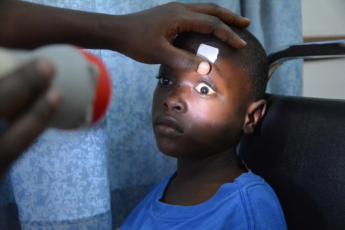 Mathias has is eyes checked in Mengo eye hospital.JPG