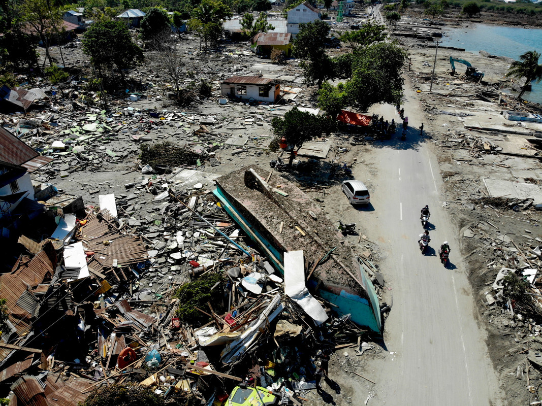 A washed up boat and collapsed buildings in Palu