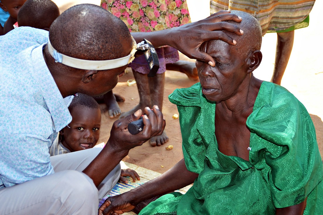 Babiwemba has trachoma trichiasis in her left eye and is examined at home in the DRC, before receiving sight-saving surgery.