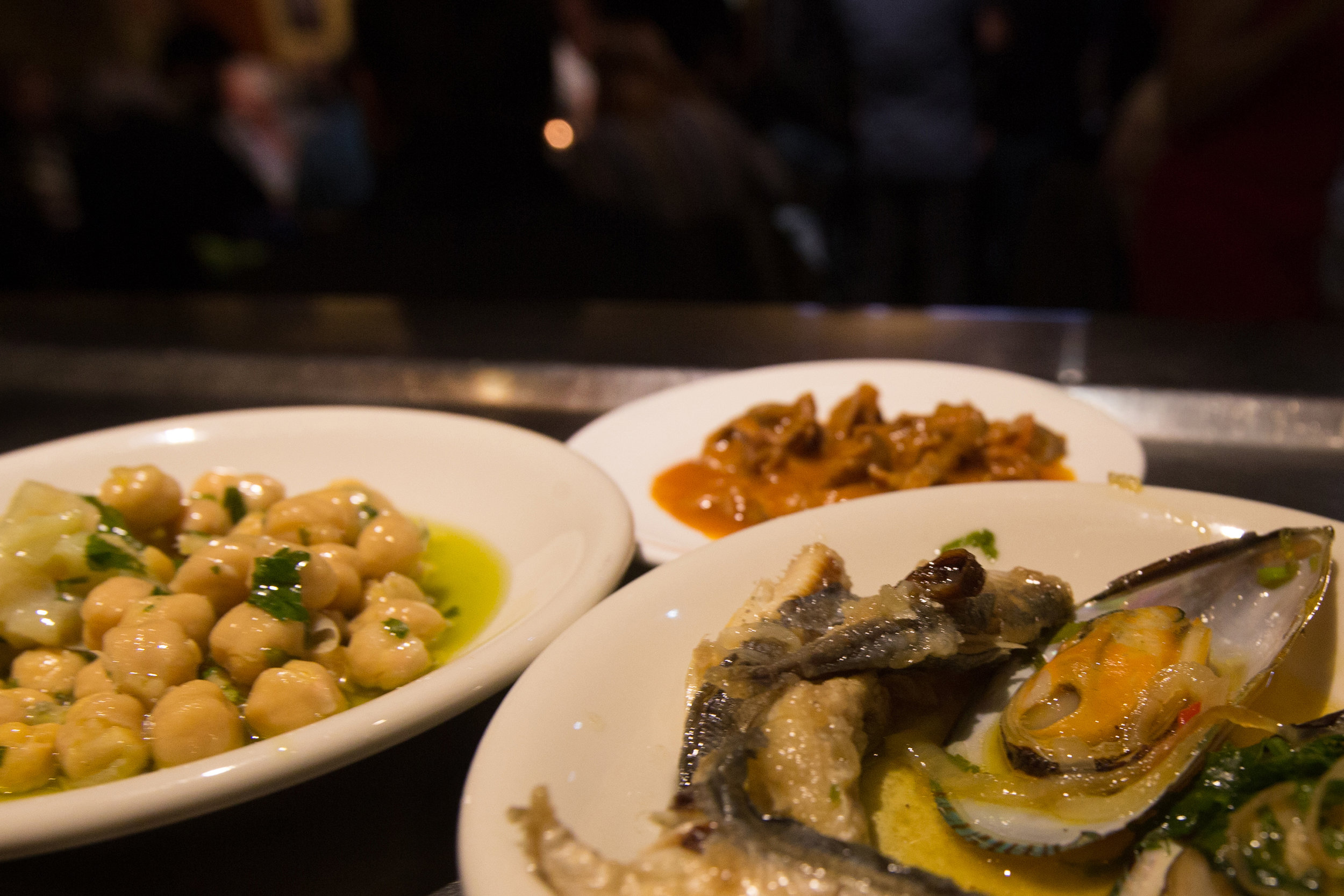 Chick peas with cod chunks, Portuguese olive oil, and herbs; cicken gizzards in a tomato sauce; Mussels with baby mackeral onoins garlic coriander, cilantro and Portuguese olive oil.