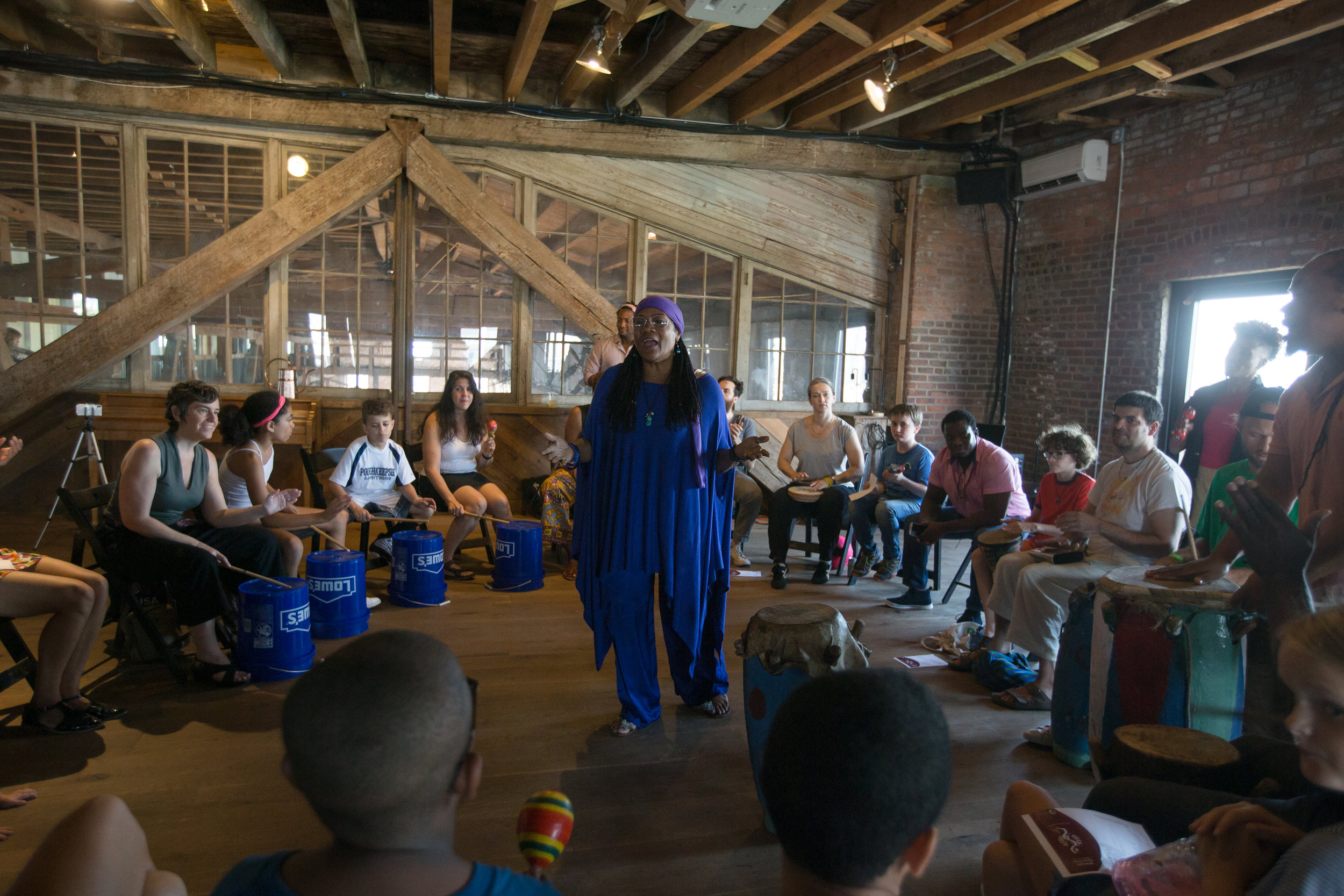 Manze of Boukman Eksperyans leading a song and  percussion, and  workshop  illuminating Haitian Roots culture for participants at Pioneer Works artist space in Red Hook Brooklyn.